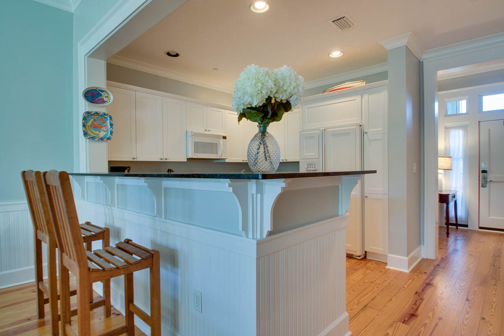 Kitchen and breakfast bar with two barstools.