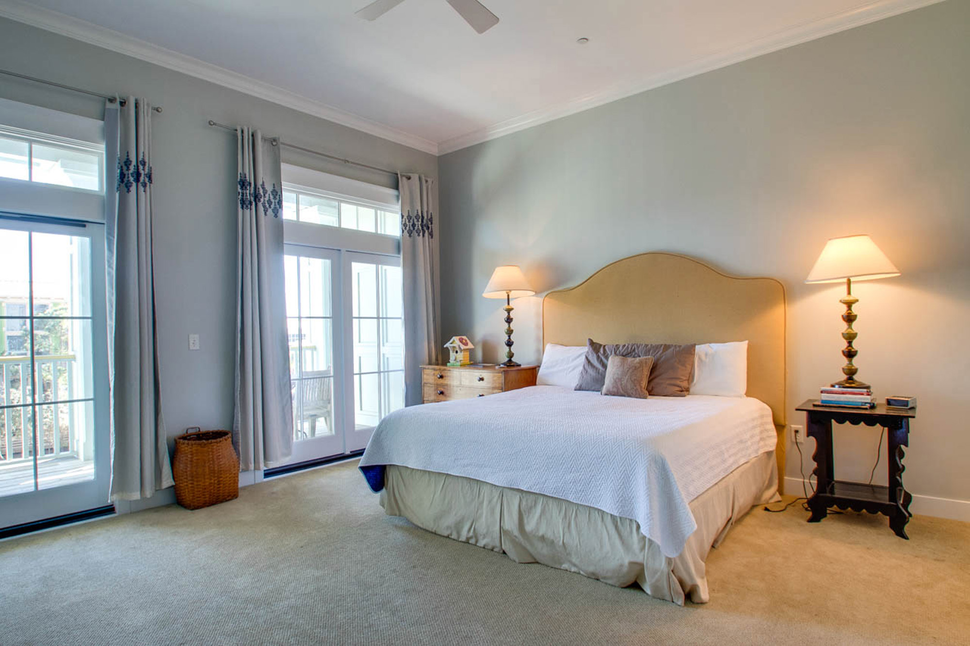 Master bedroom with king sized bed and private balcony.
