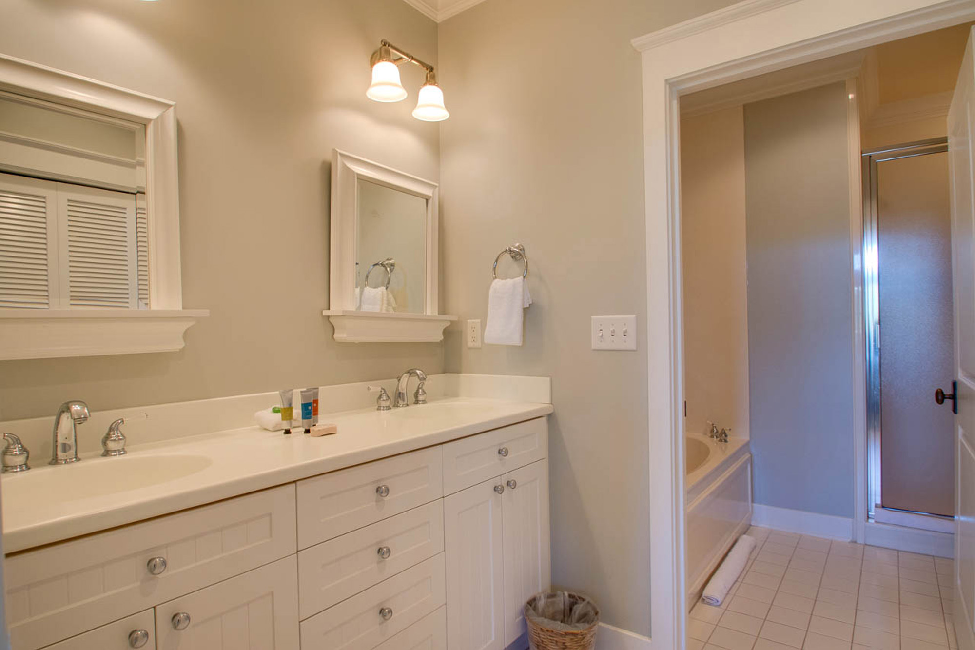 Master ensuite bathroom with double vanities, separate tub and shower.