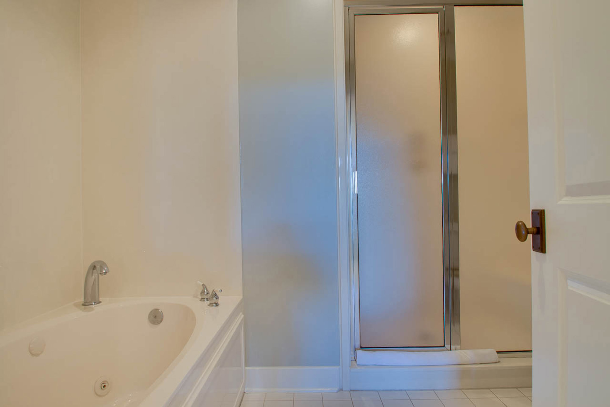 Master ensuite bathroom with separate tub and shower.