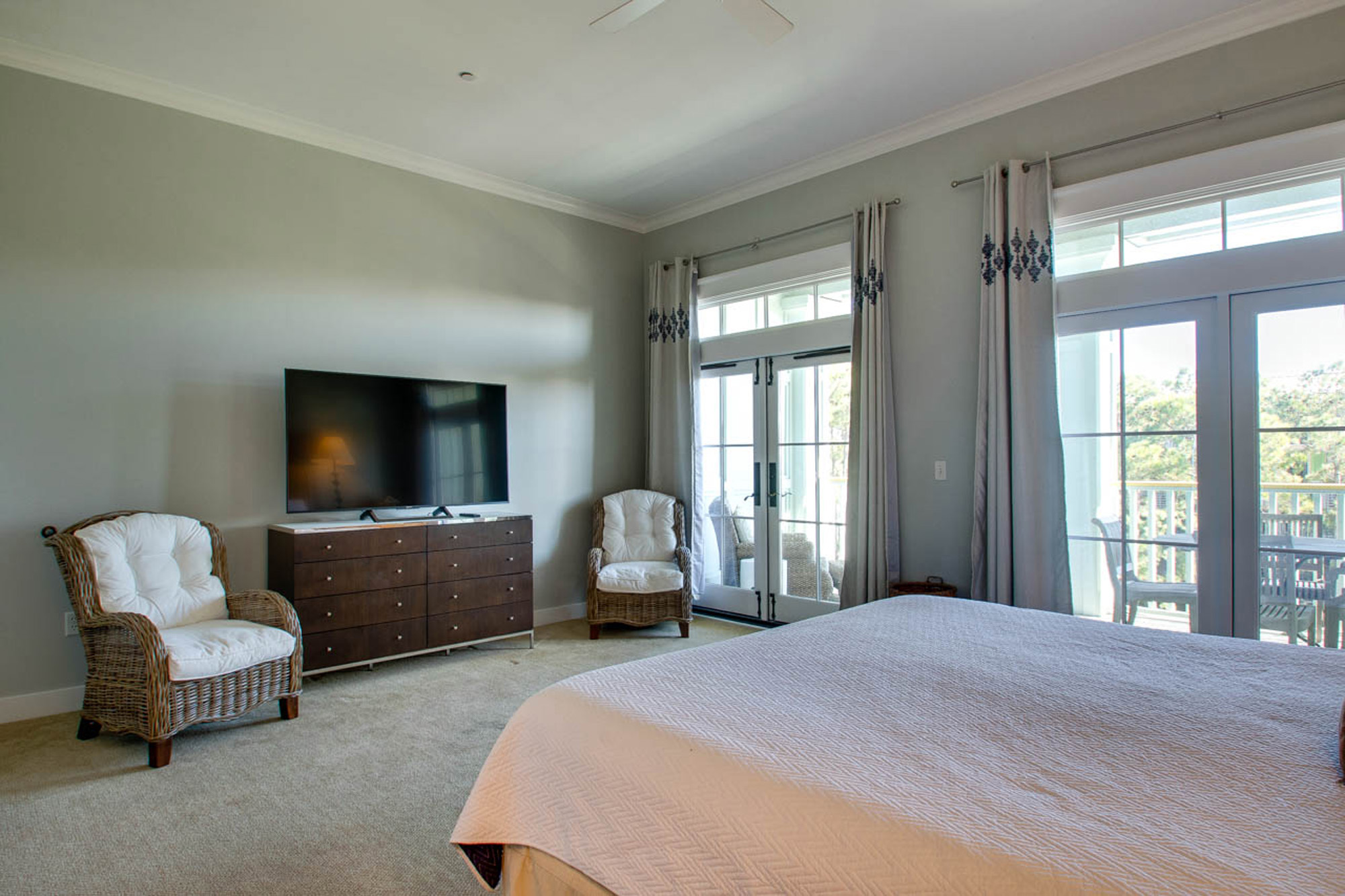 Master king sized bedroom with TV and private balcony.