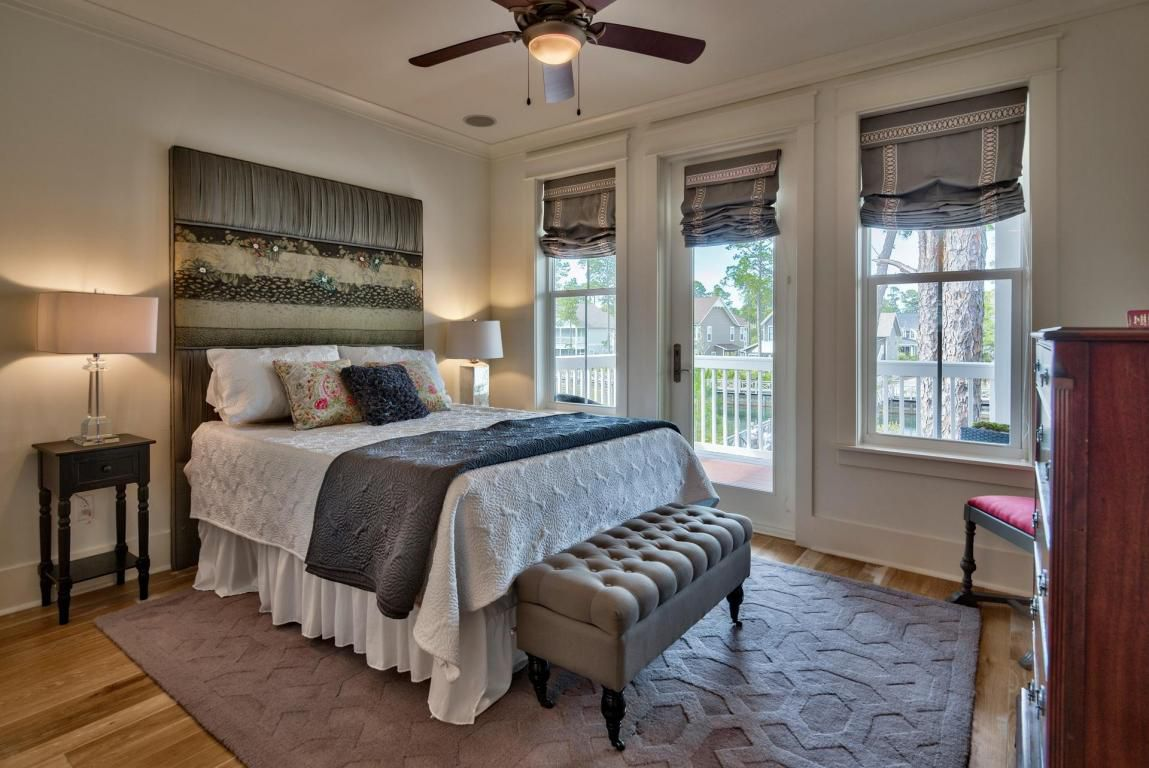 Second floor additional queen suite with beautiful, stylized bed frame