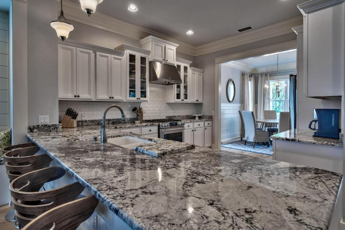 Gorgeous granite countertops providing additional bar seating and meal preparation area
