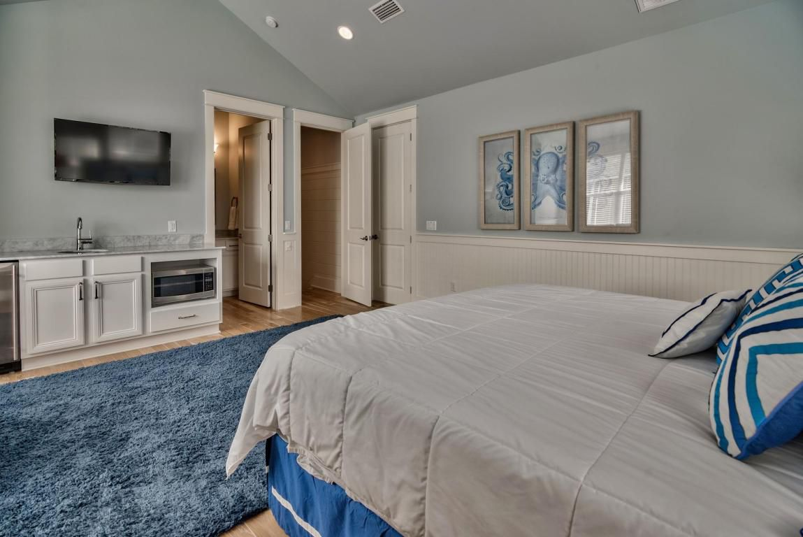 King sized guest suite features kitchenette and en-suite bath, and common area with captain's bunks