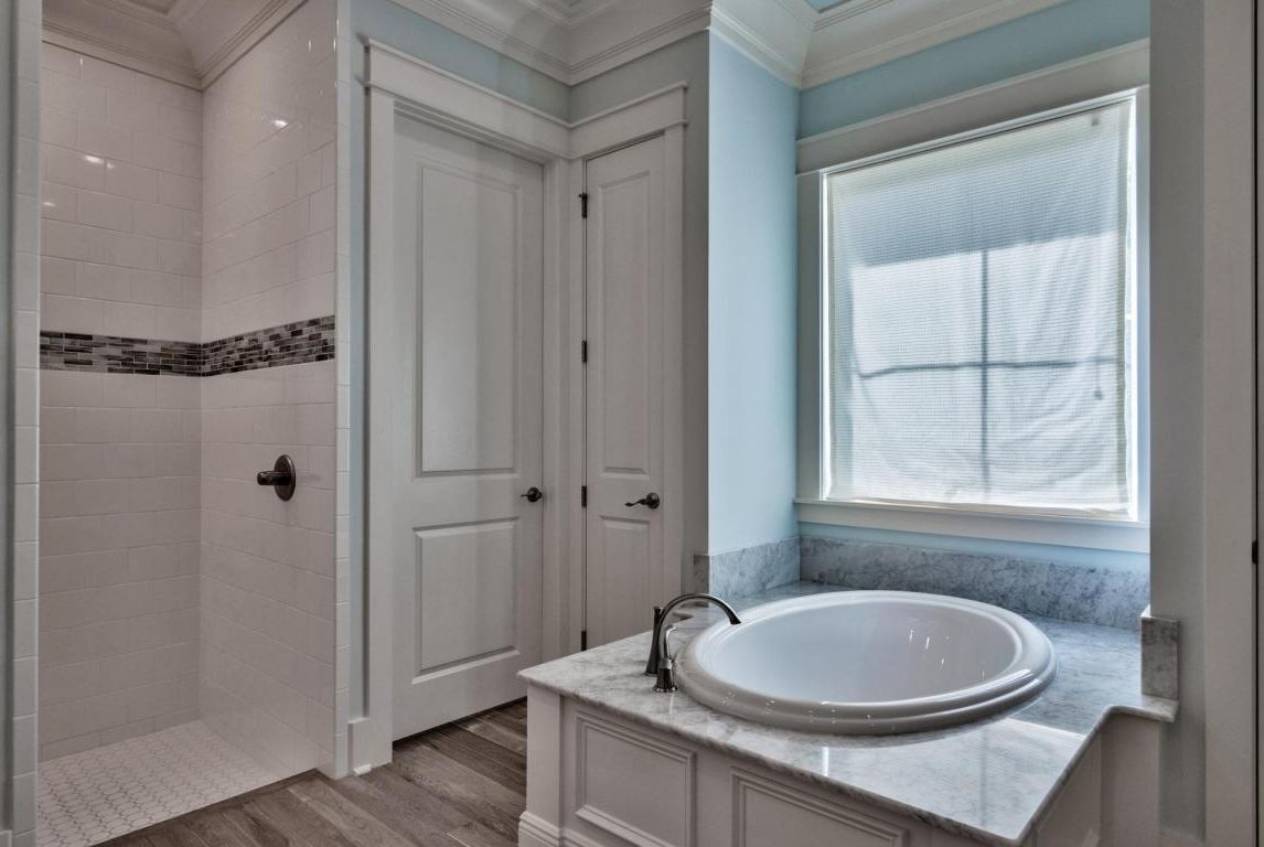 Master bath soaking tub with view of walk-in shower