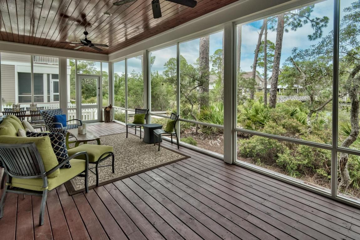 Screened in outdoor living space with exceptional views of lakes
