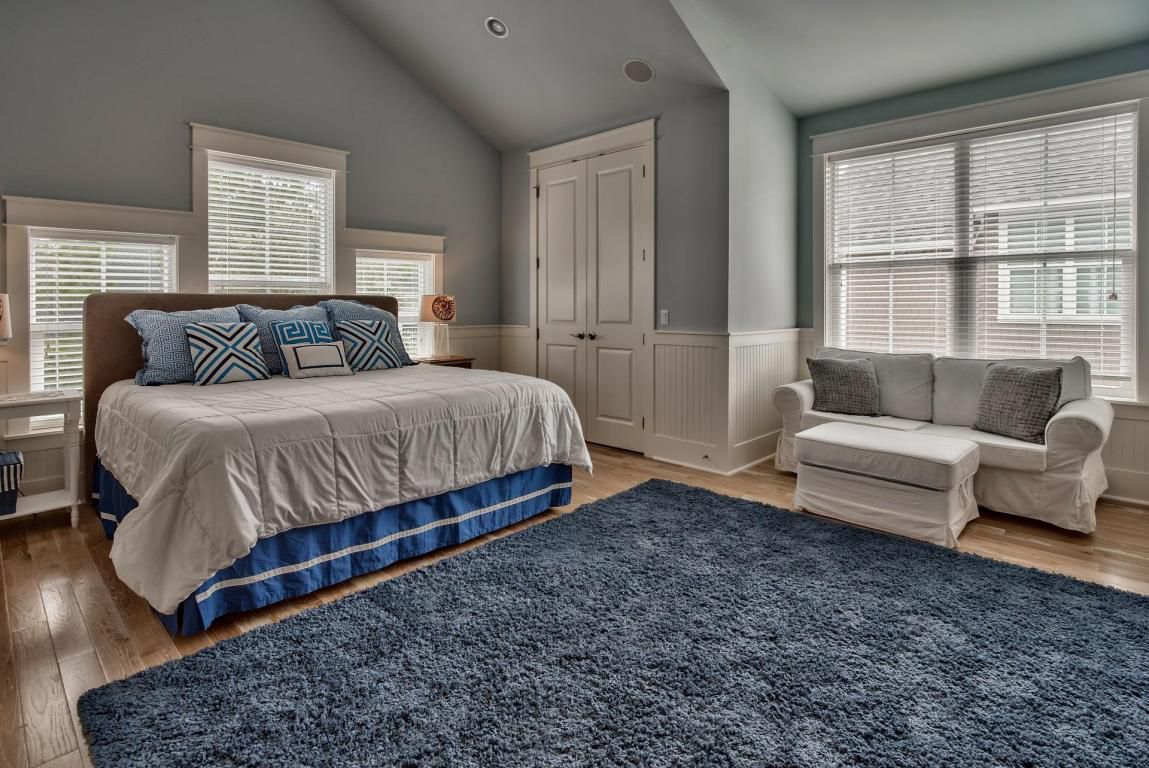 Separate second floor guest suite with king sized bed and sectional
