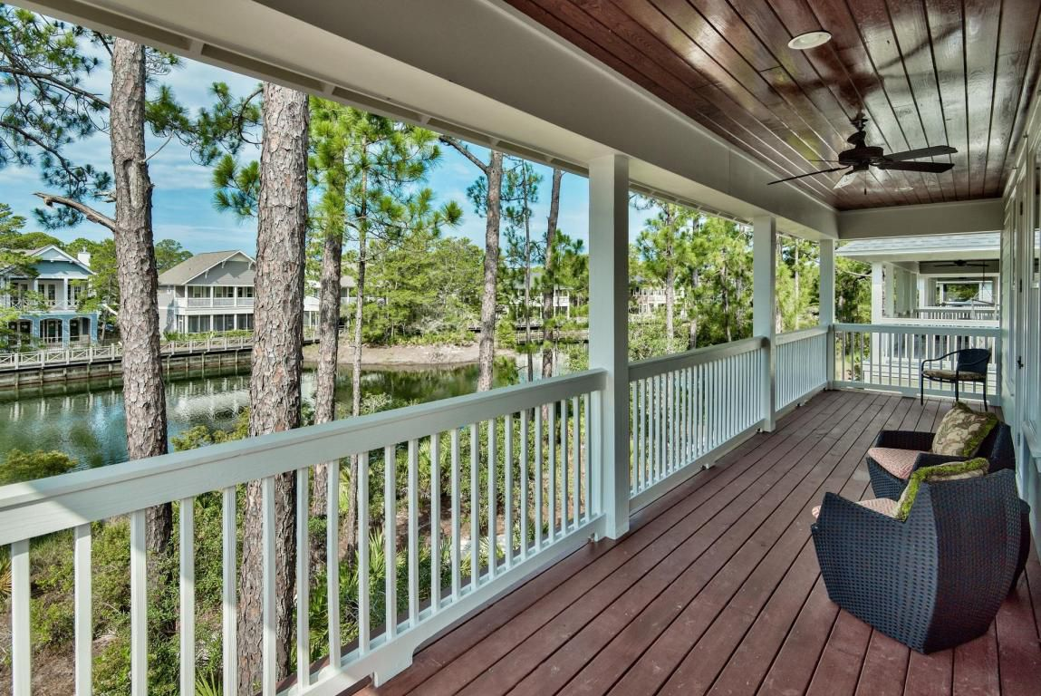 Second story outdoor veranda with seating for family