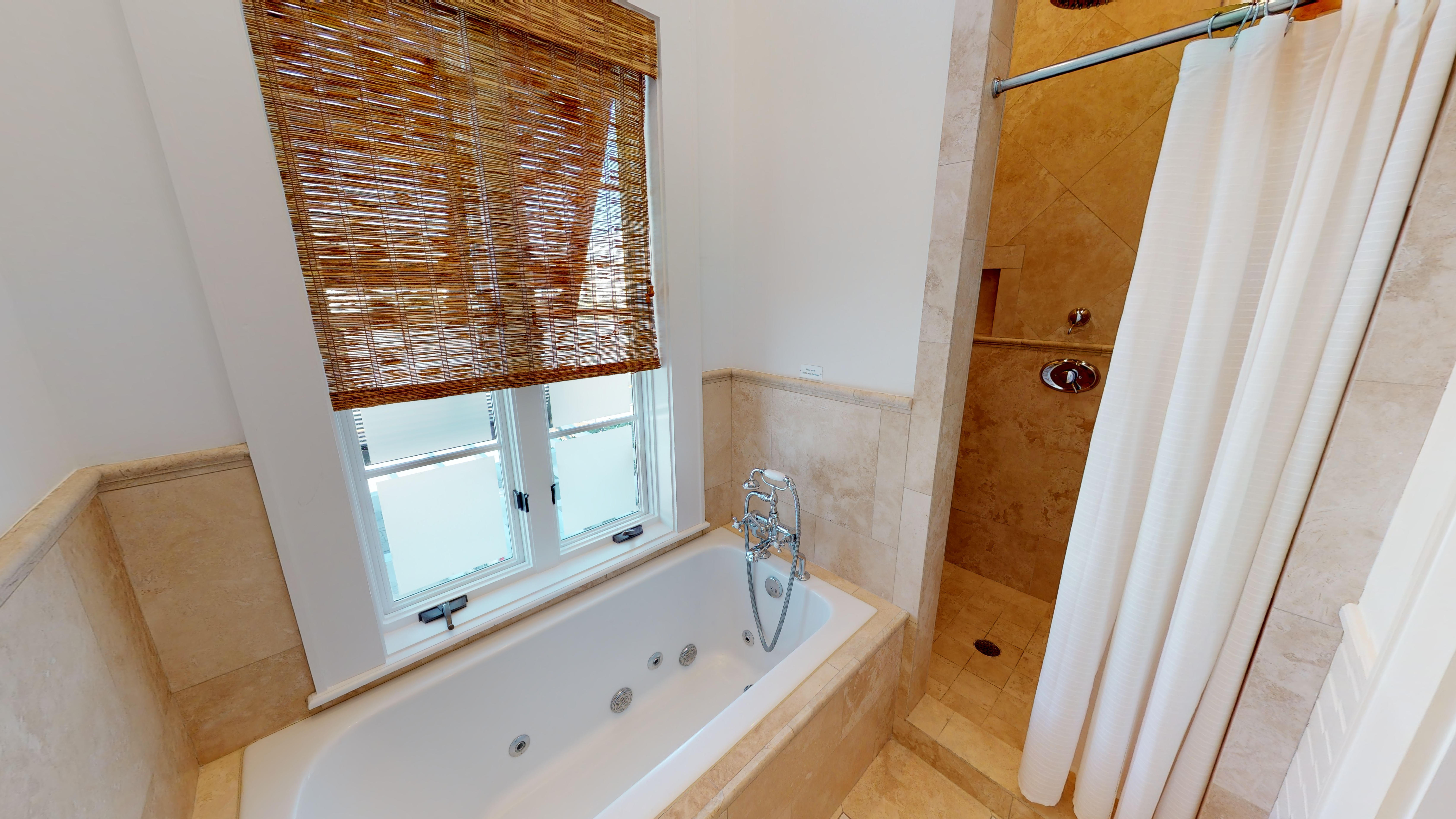 Master bath features a soaking tub and separate shower