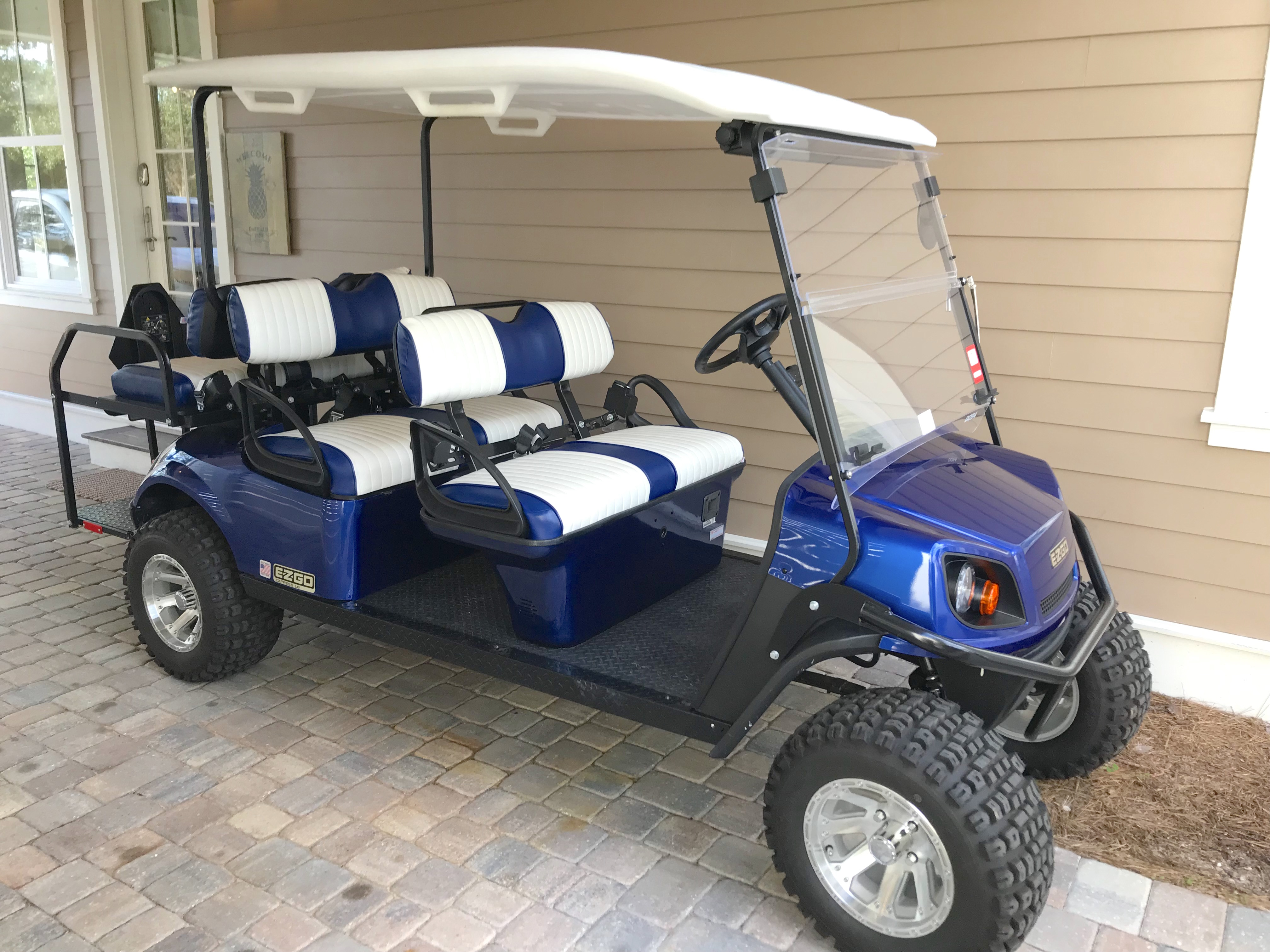 6 seat golf cart is included with the home