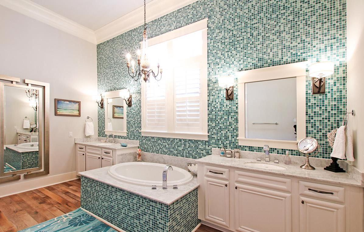 Emerald colored en-suite master bath with double vanity, separate walk in shower and stunning soaking tub.