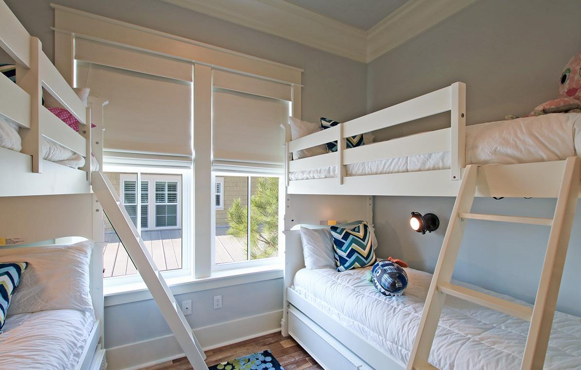 Lovely bunk room with four twin beds with bright lighting