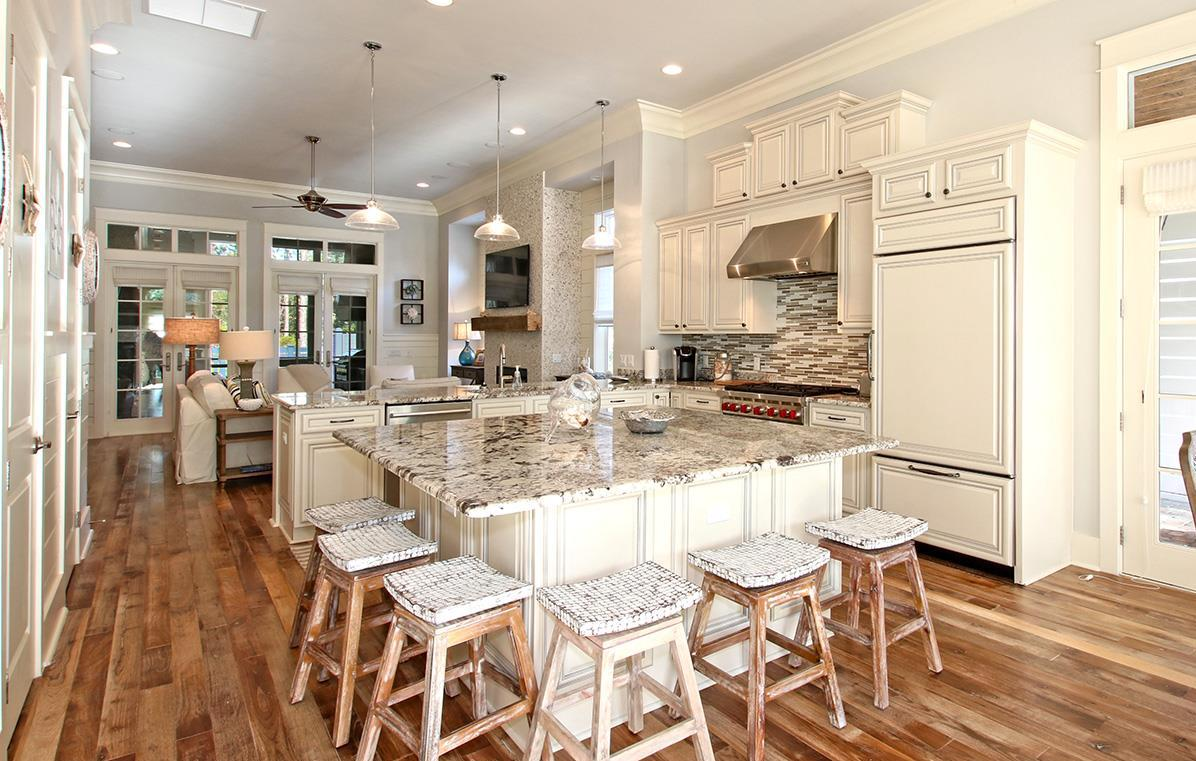 Spacious kitchen provides ample space for large party and luxurious marble finishes to expel elegance