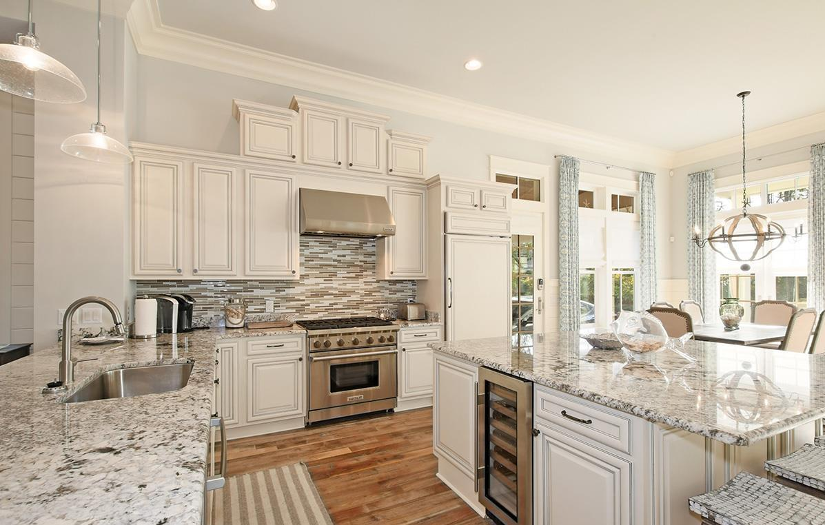 Stainless steel appliances and hide away fridge offer a sleek feel to this wonderful space