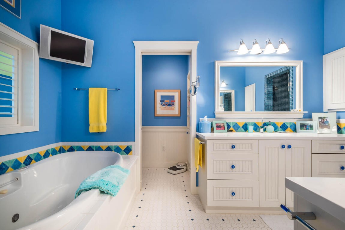 Huge master bathroom with a jetted tub