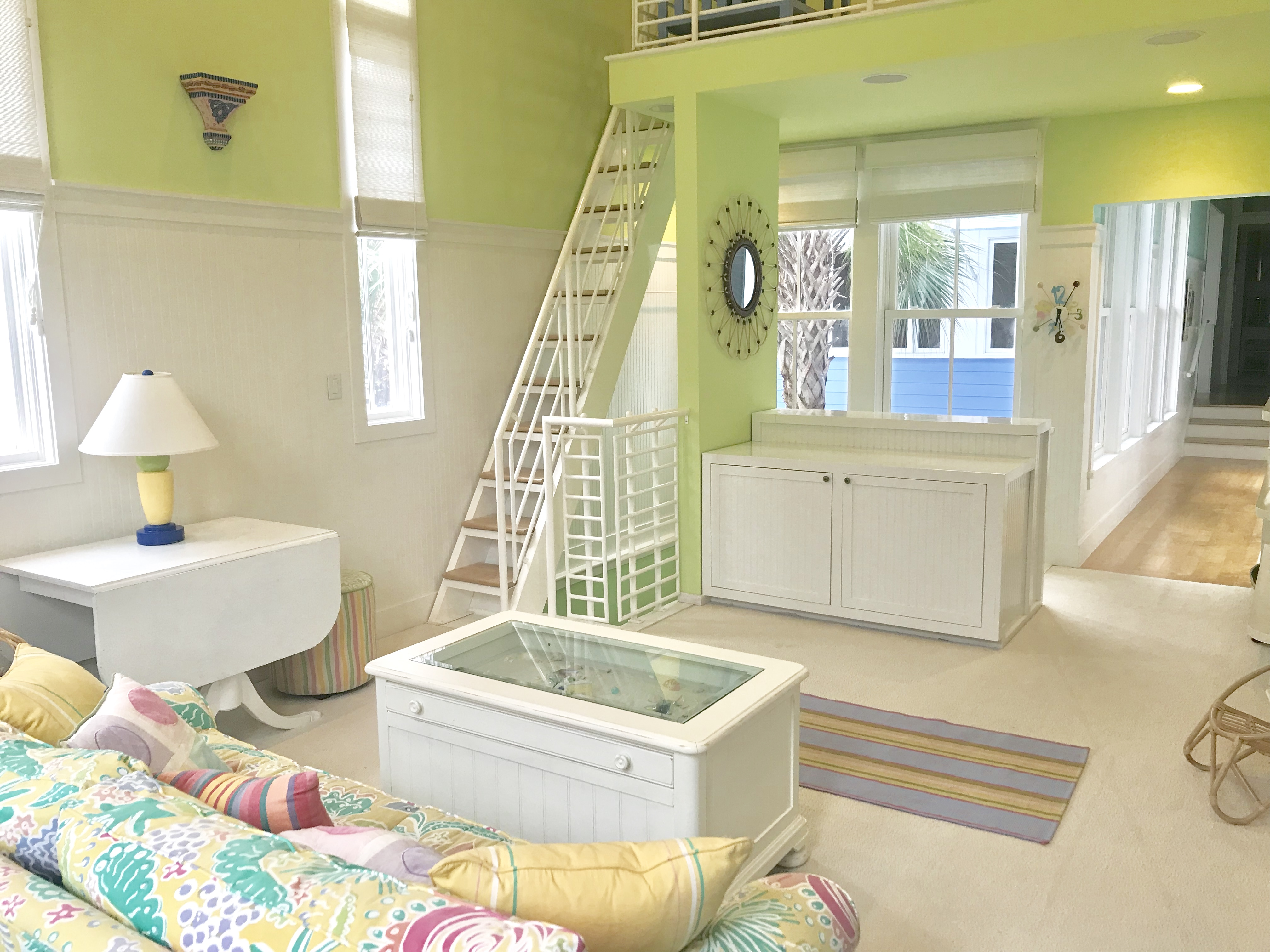 The north wing of the home has a second living area, with a queen sleeper sofa, bunk room and a loft that has a full sized day bed.