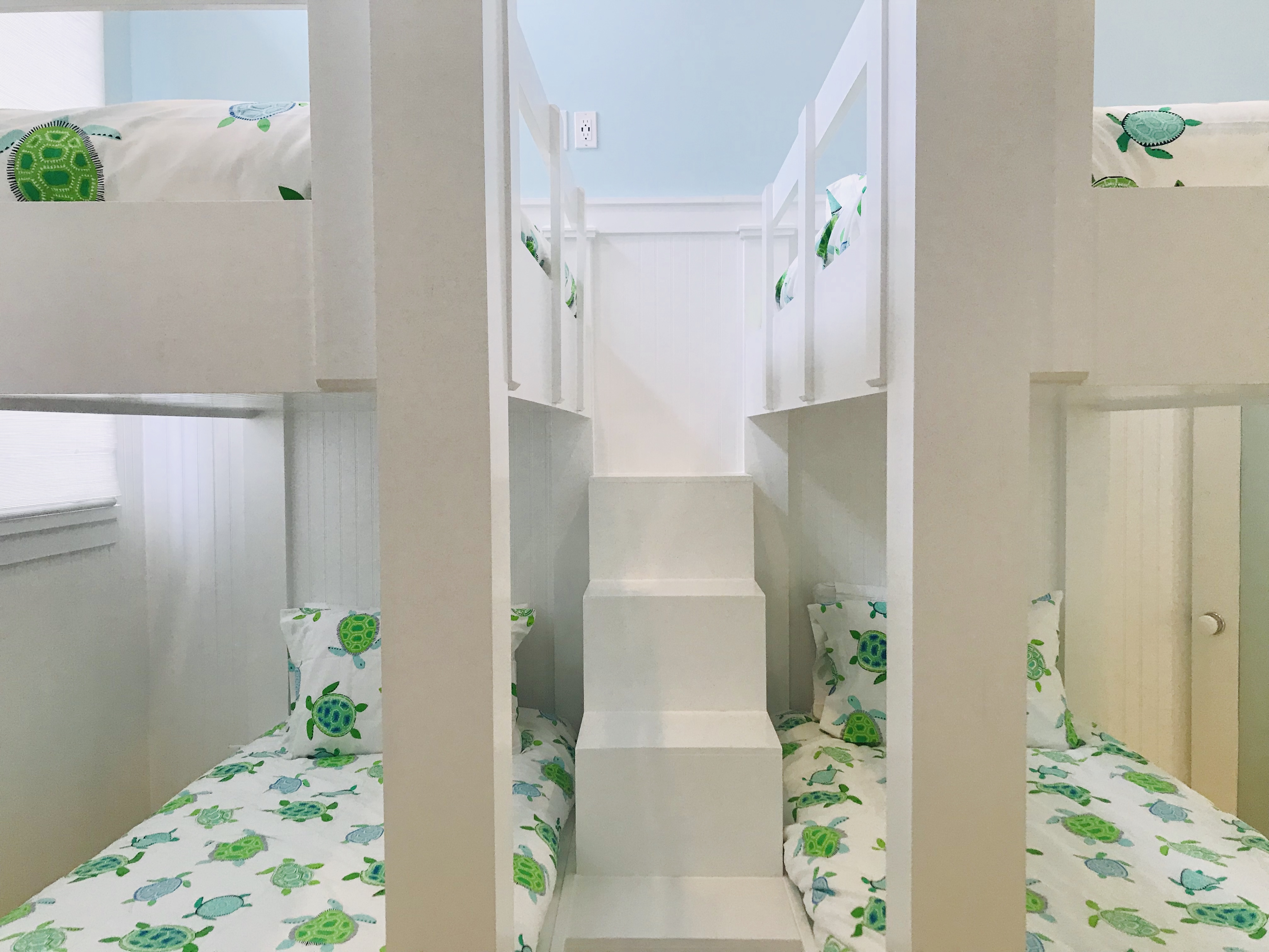 Wonderful, custom staircase to access two sets of the bunk beds.