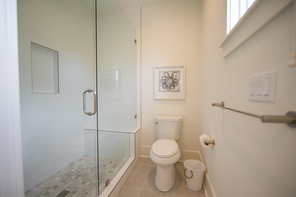The 4th floor bath features a private shower room
