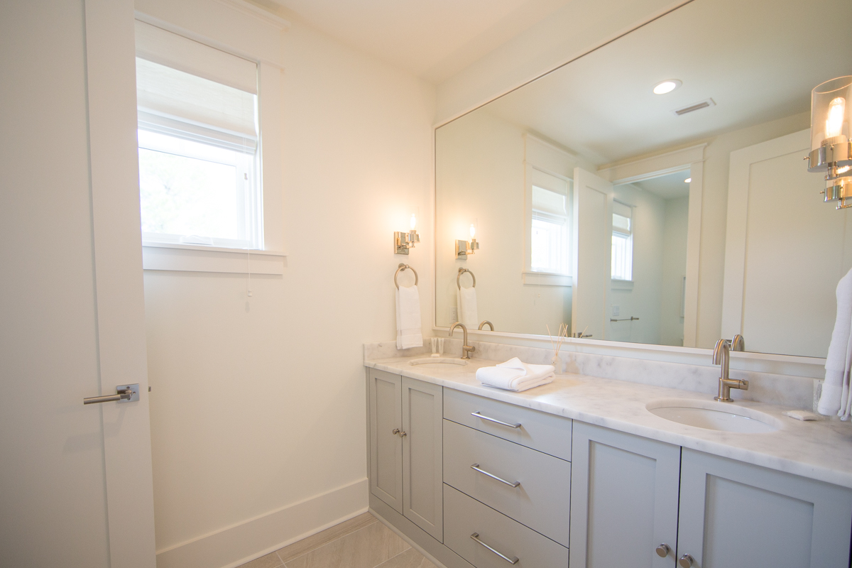 4th floor guest bathroom with a double vanity