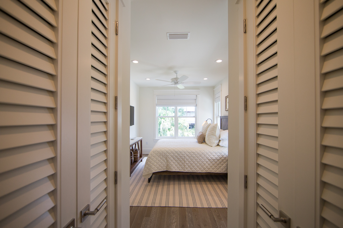 Closets flank the walkway into the attached bathroom