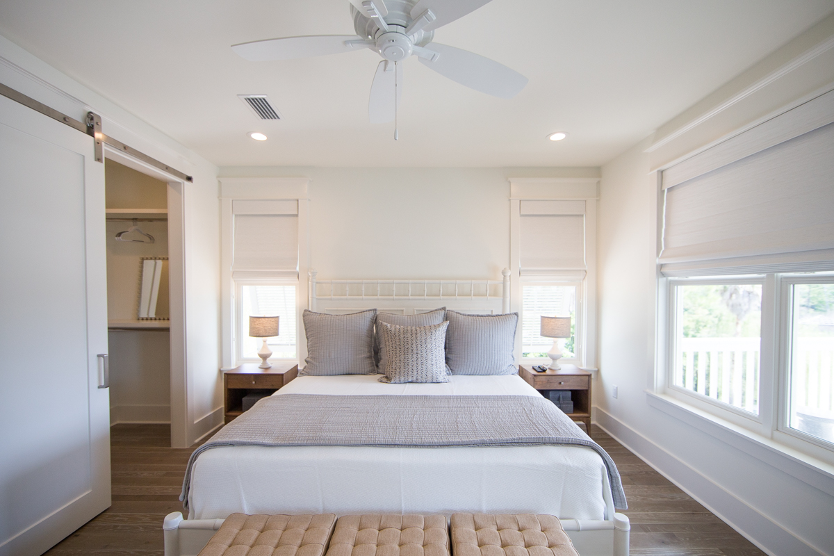 Creamy whites and grays provide a peaceful vibe in this master bedroom