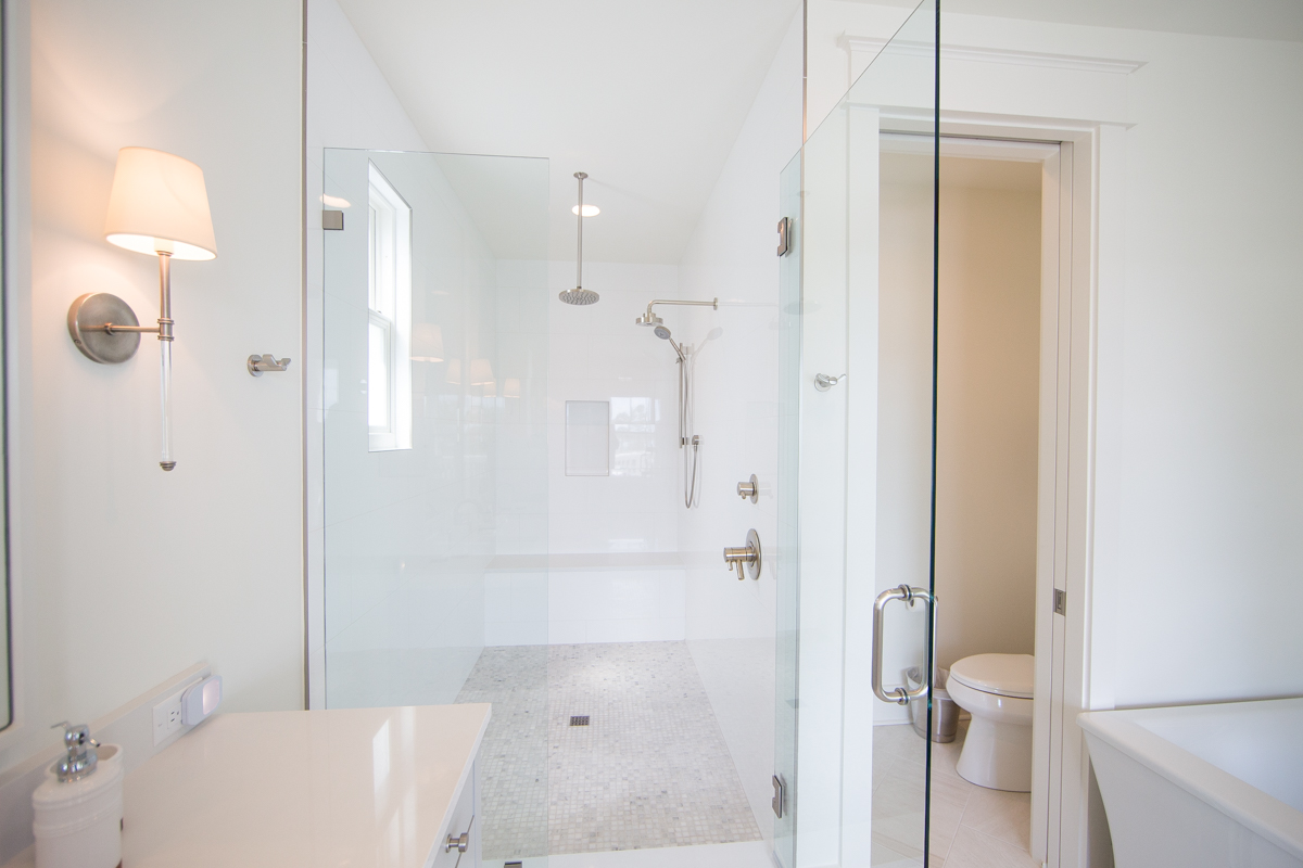 The third floor master features a beautiful shower with a rain shower head and hand held nozzle