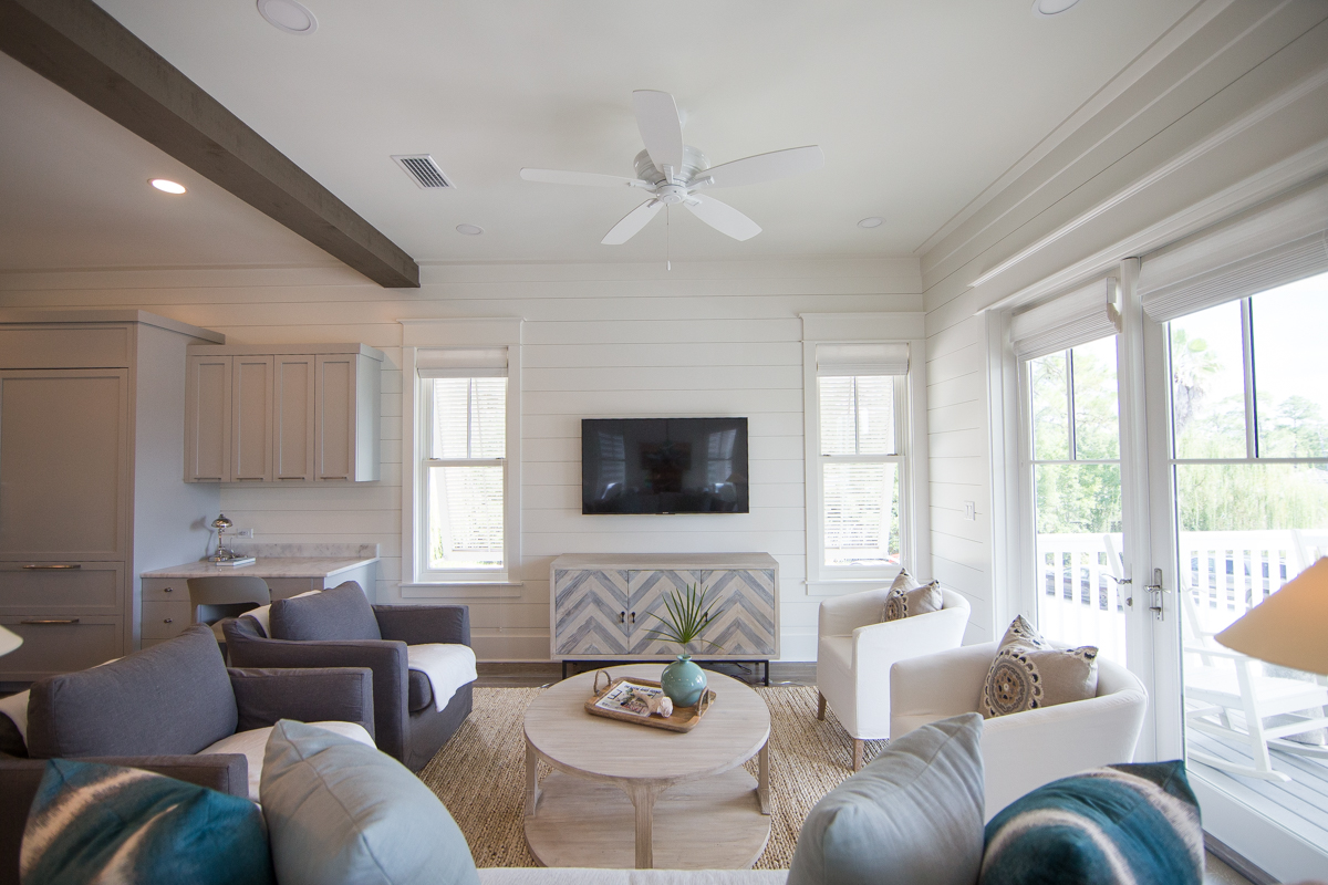 The living area has french doors leading to the balcony area