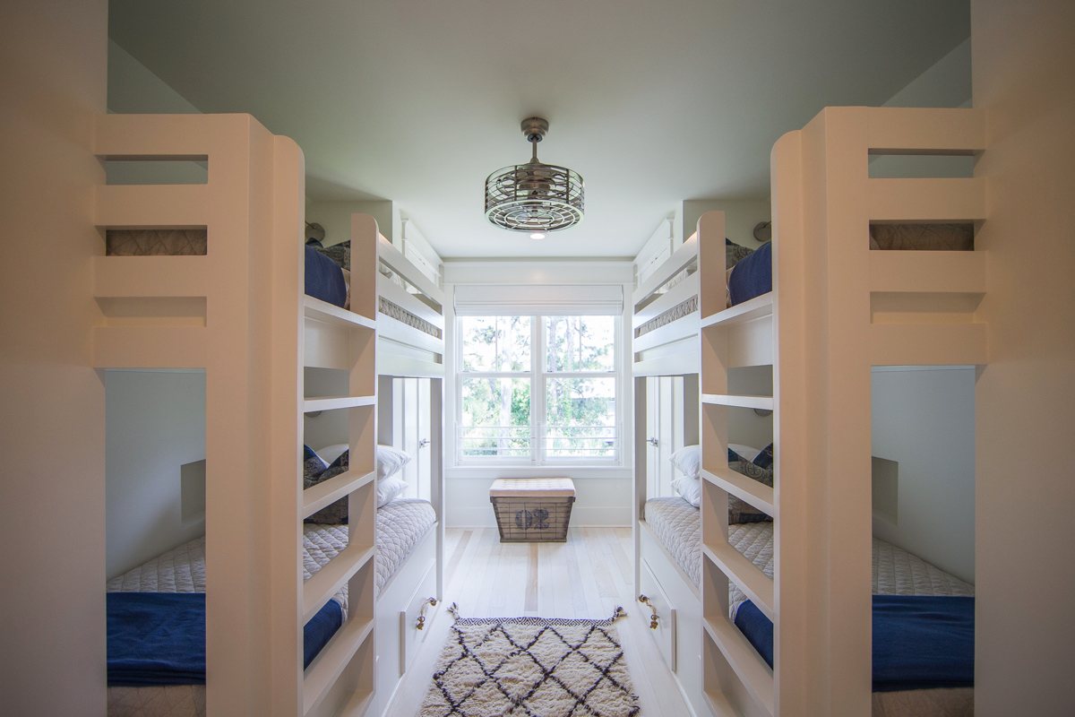 Lovely built in bunk room with 2 sets of bunk beds and closets