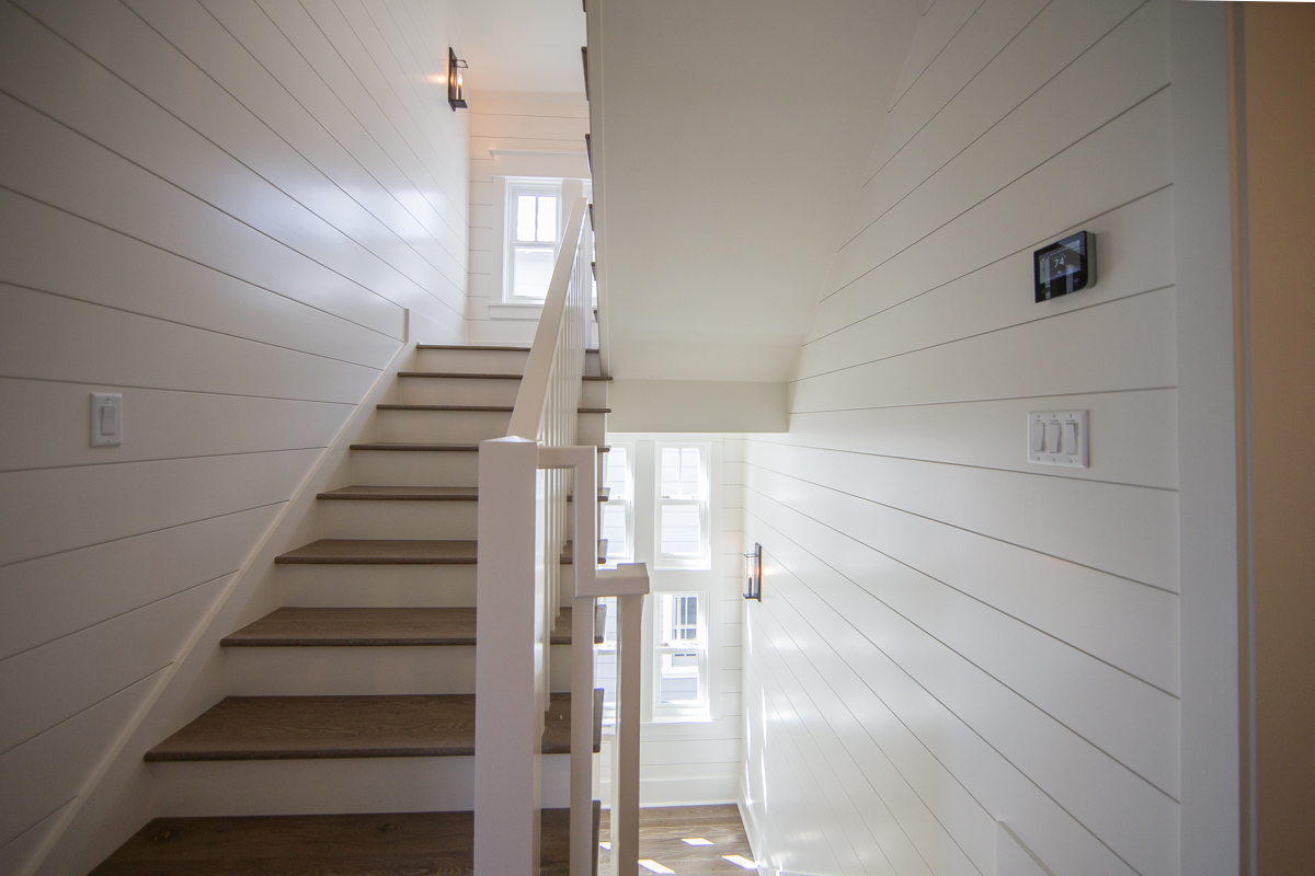 Lovely, shiplap walls in the hallways leading to each floor