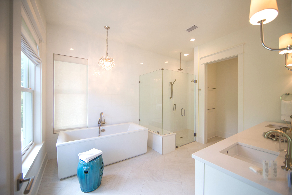 Luxurious master bathroom with a deep soaking tub and separate shower