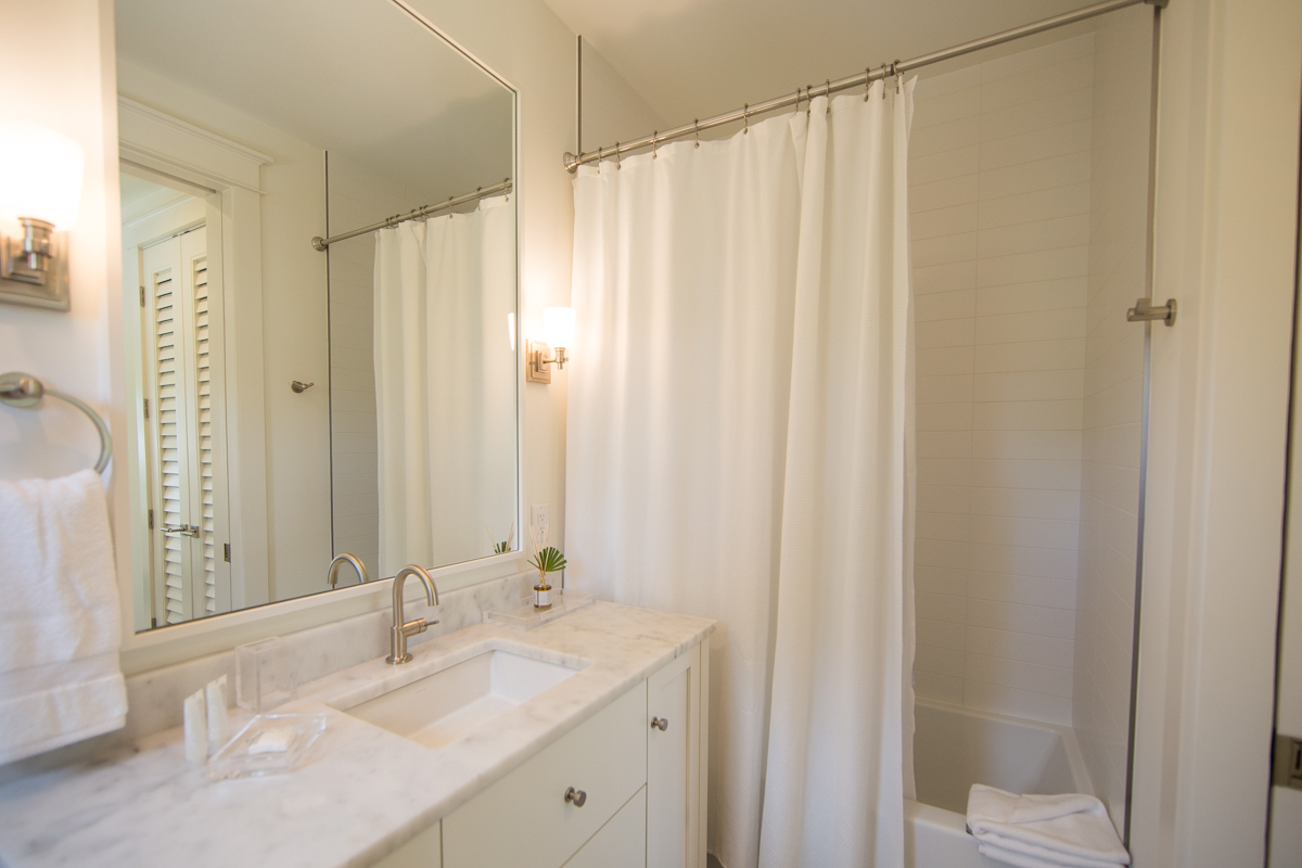 The queen bathroom has a single vanity and a tub/shower combo