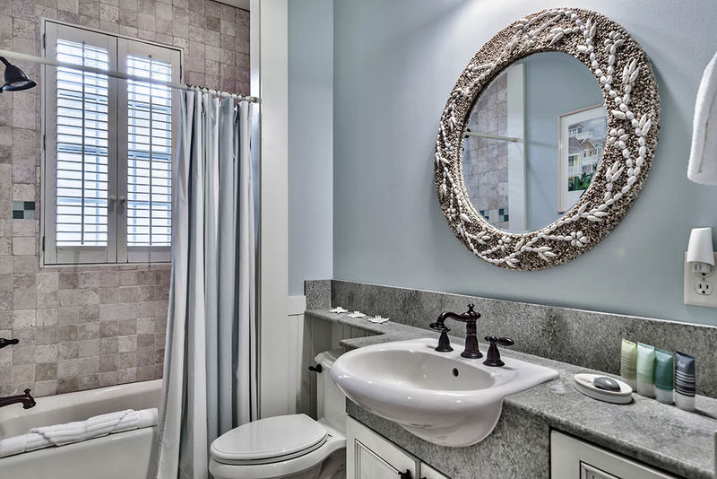 Connecting twin bathroom with a tub/shower combo