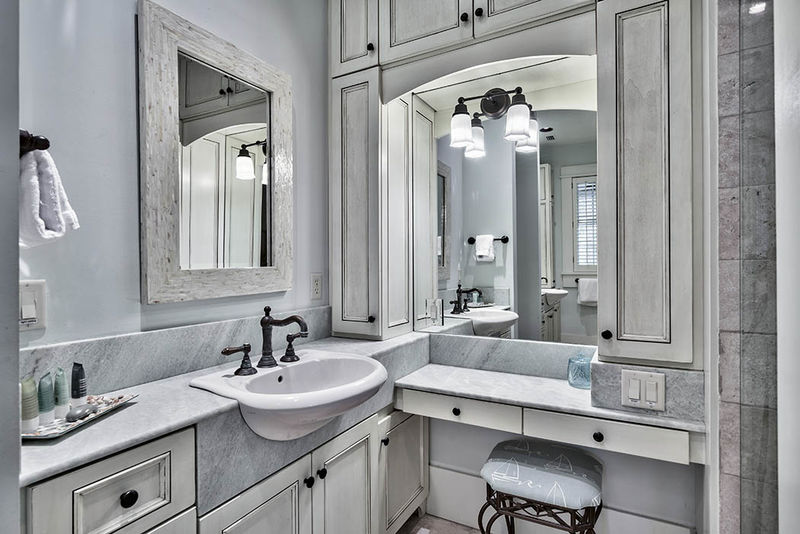 The master bath features double sinks and a vanity area