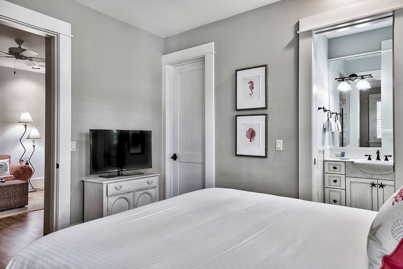 The queen bedroom has a connecting bath and TV