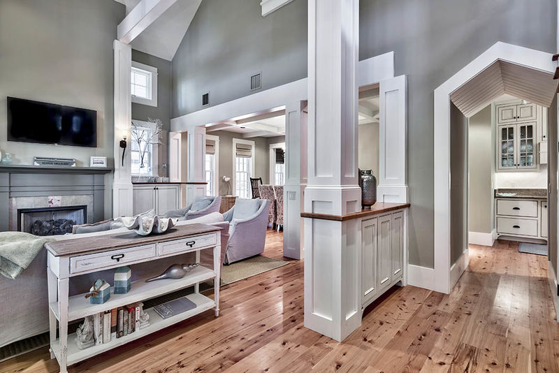 You are welcomed into the home with warm and inviting tones and unique architectural door ways