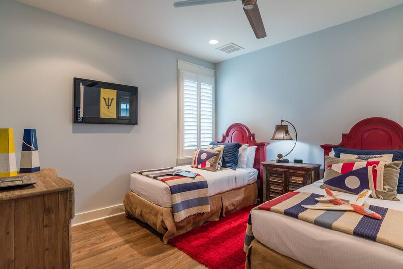 Adorable twin bedroom with flat screen TV