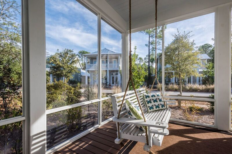 Swing away on this comfy porch swing, one of the unique features of this house v others in the neighborhood