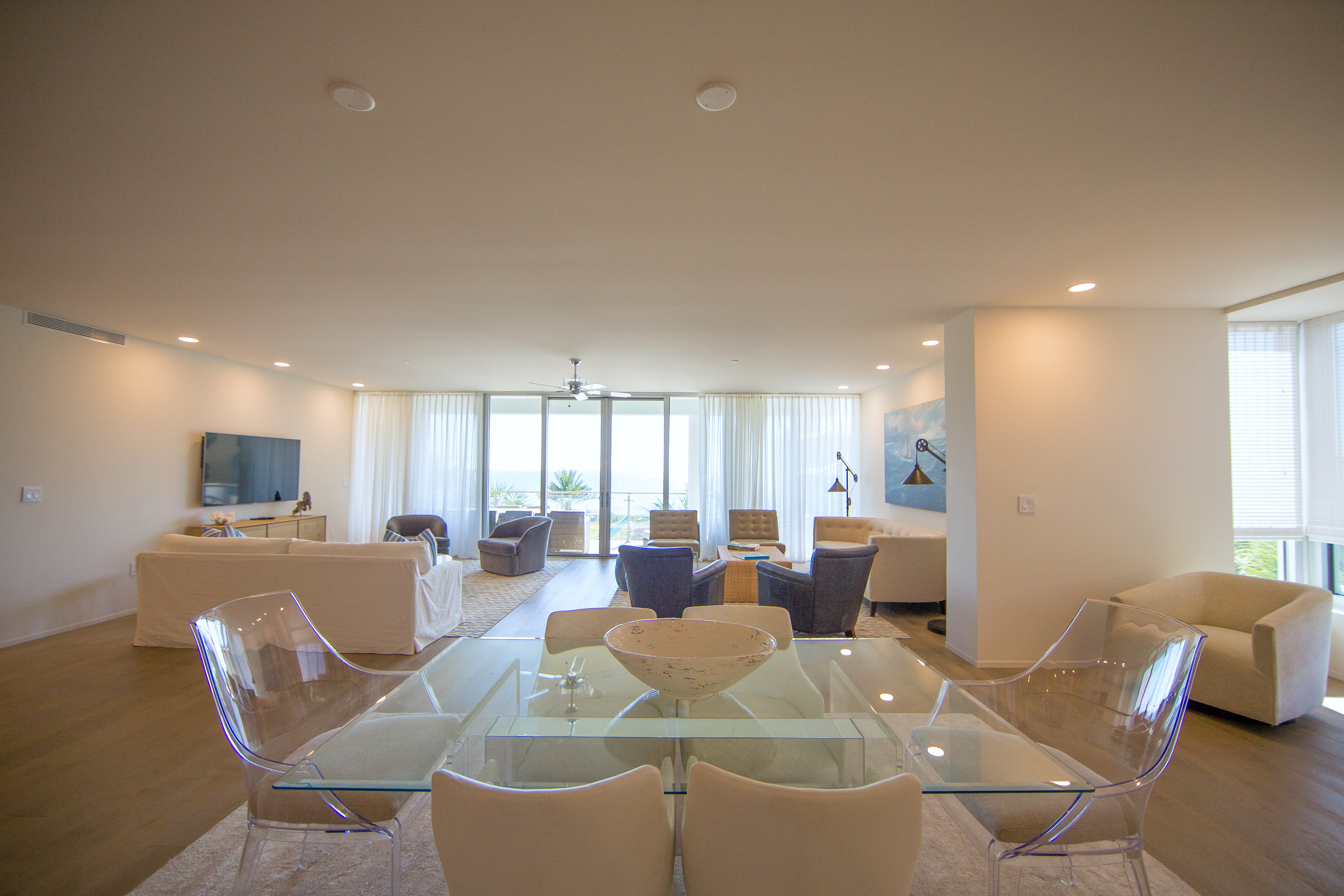 Beautiful dining table located in between the kitchen and living areas