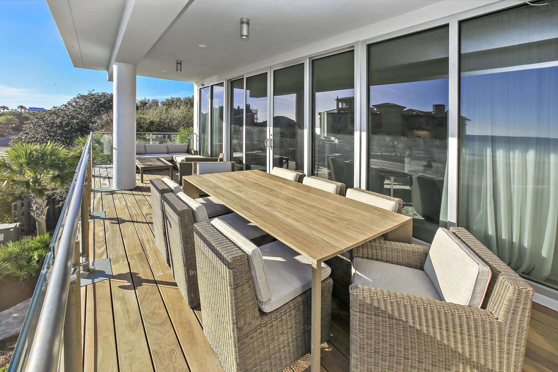 Large dining table and outdoor seating on a huge balcony