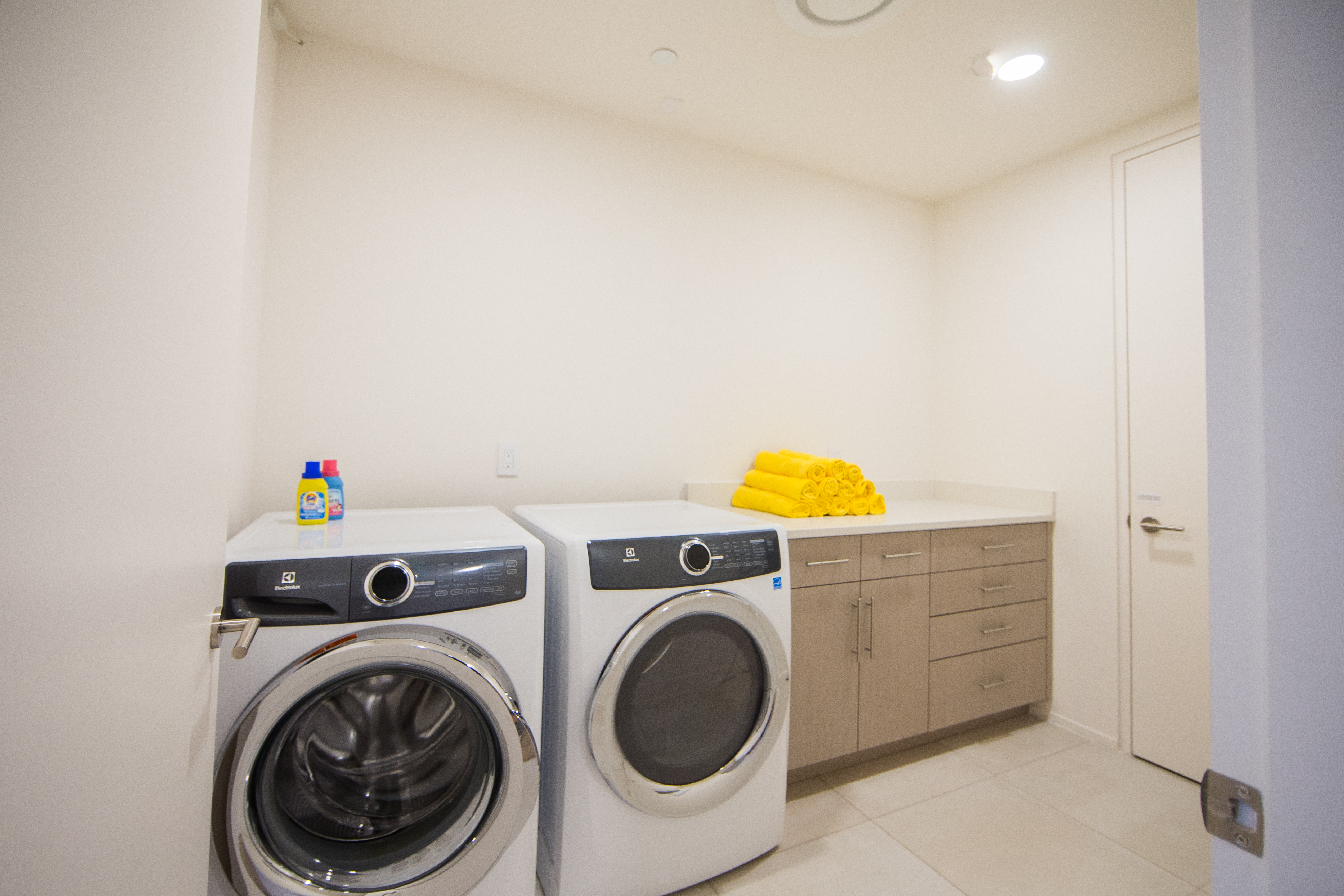 Large laundry room with space for folding clothes