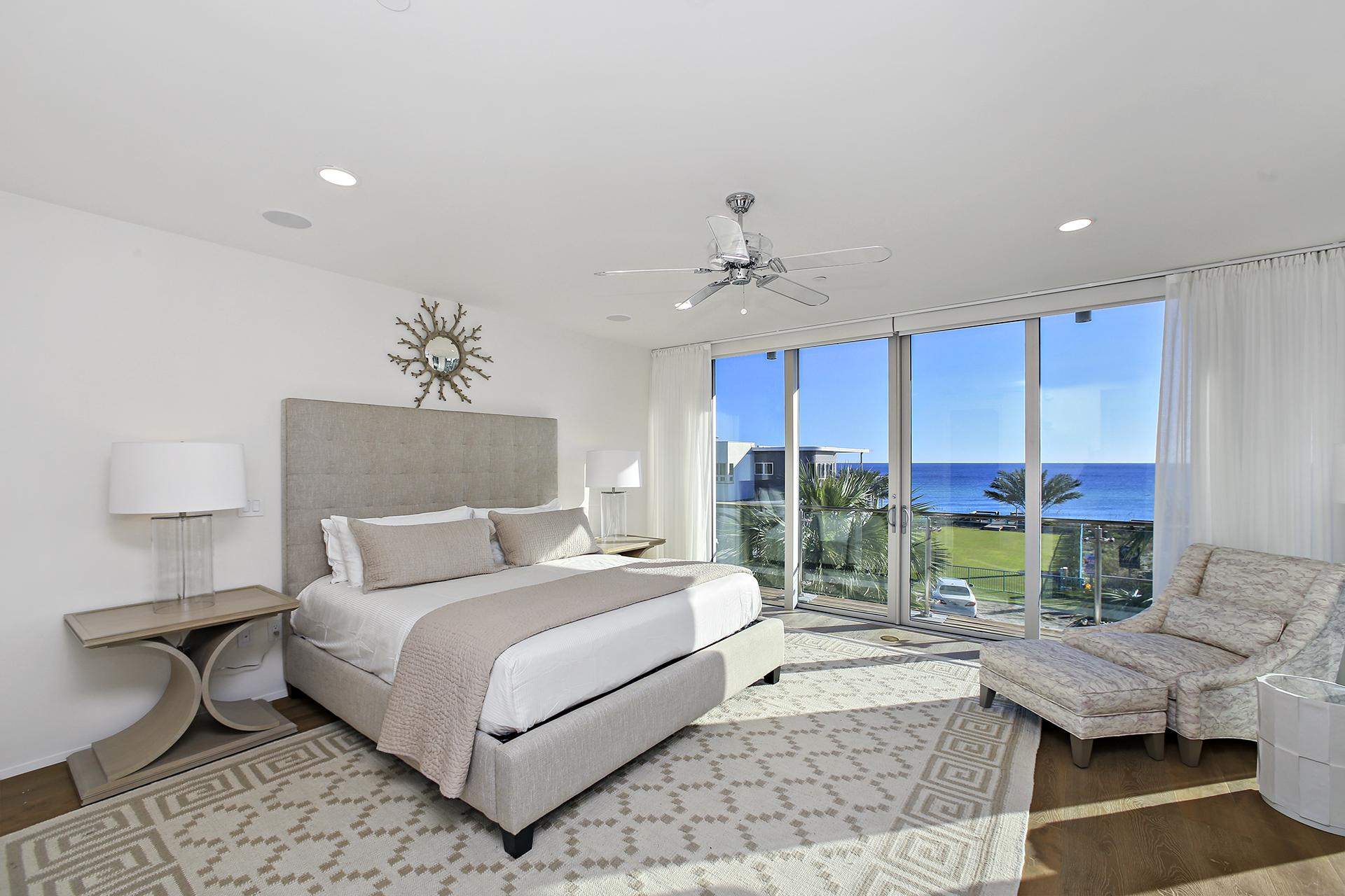 Sophisticated master bedroom with full views of the Gulf
