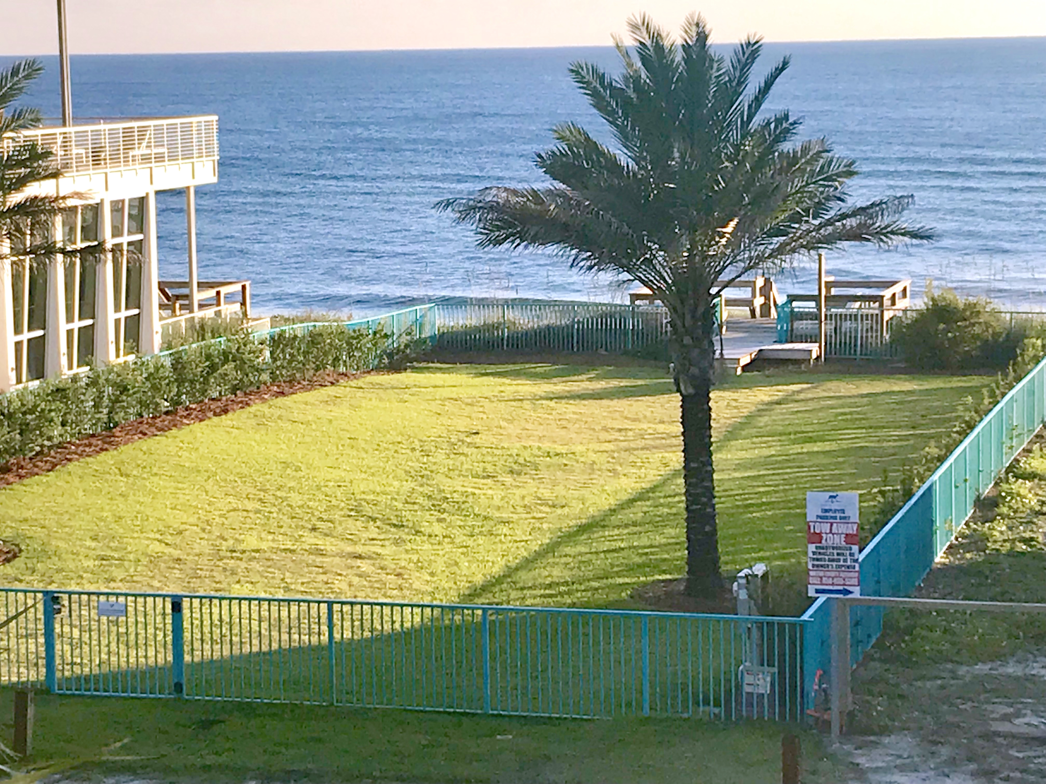 The Viridian has a wonderful, private green space with gated entry to their dune walkover