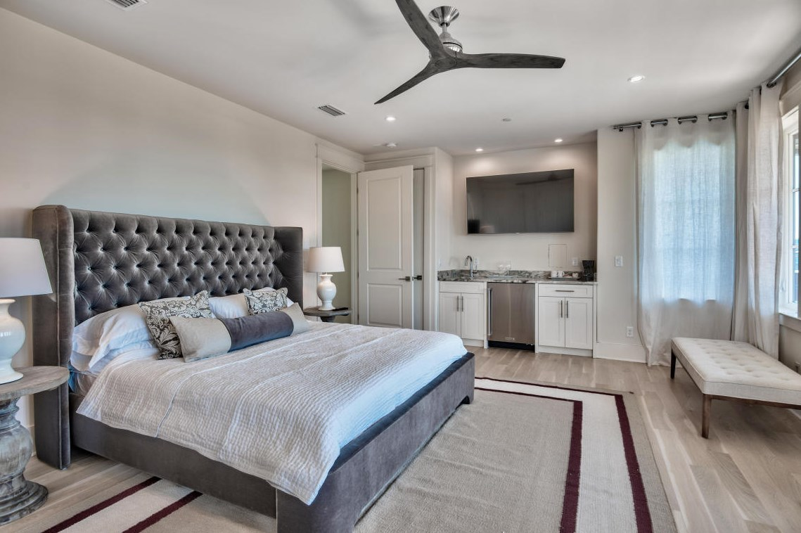 A big screen TV and a wet bar are highlights in this master retreat