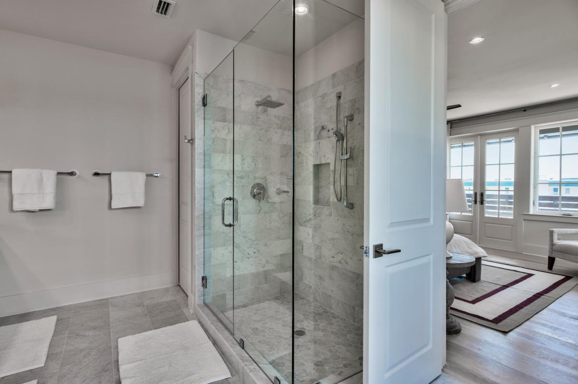 The master bath features gorgeous marble tile