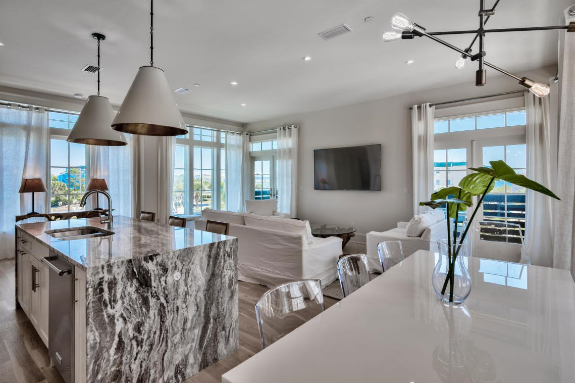 Open concept kitchen, dining and living. Gorgeous counters are a highlight in the kitchen!