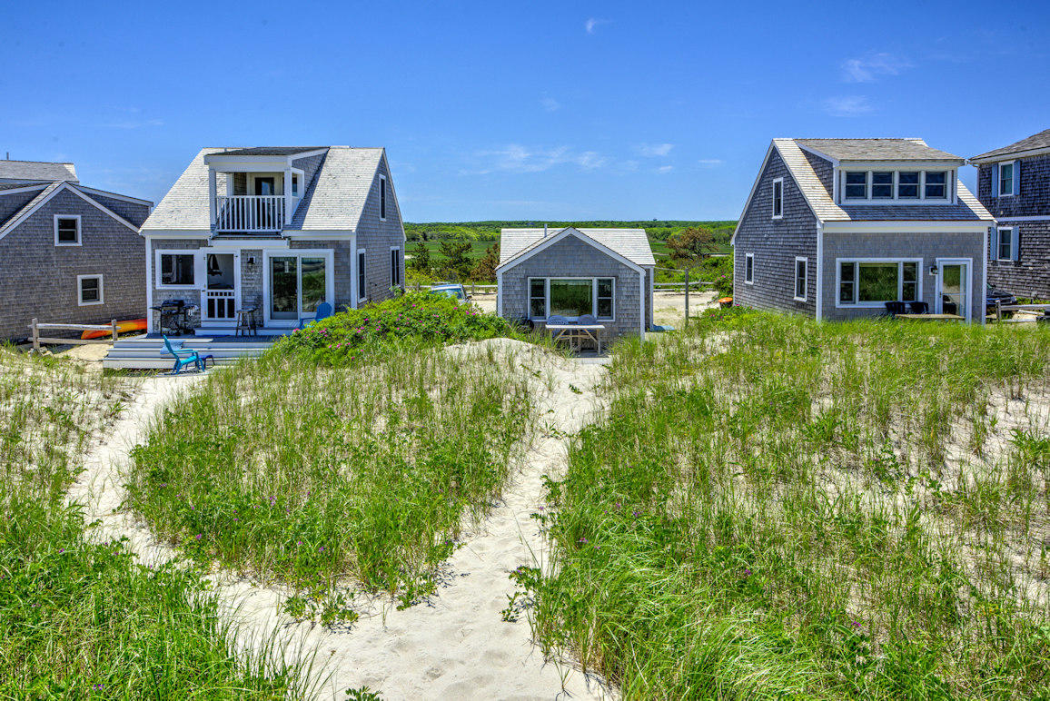 Cottage is nestled in dunes
