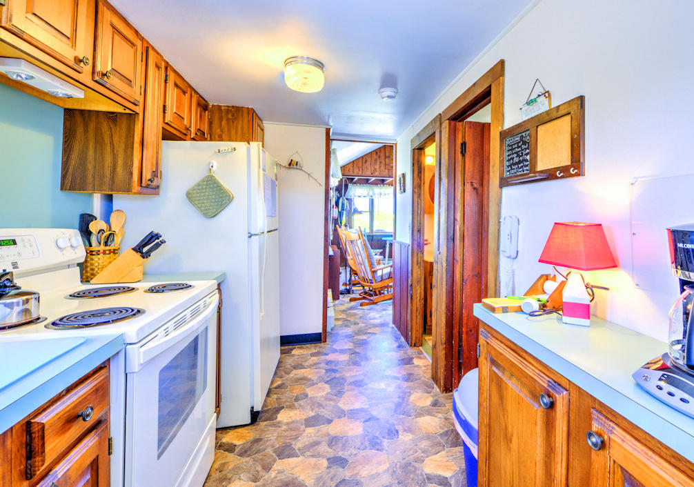 Kitchen leads to Living area