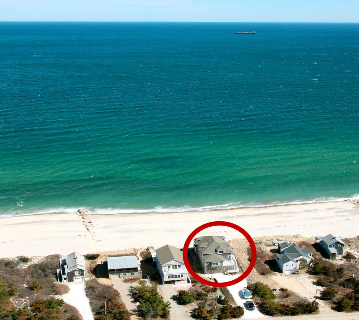 Aerial of house, beach and ocean