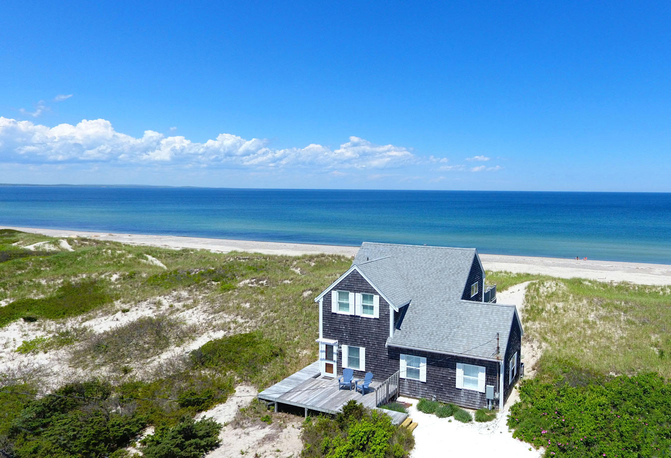 Aerial of cottage and beach