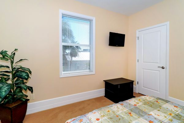 Guest bedroom with flat screen.
